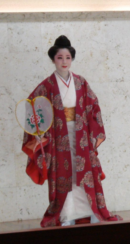 Kagiyade Fu Classical dance representing a happy celebration. This is a traditional priestess costume.
